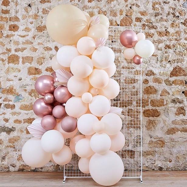 arche de ballons pastel pêche ave feuillage